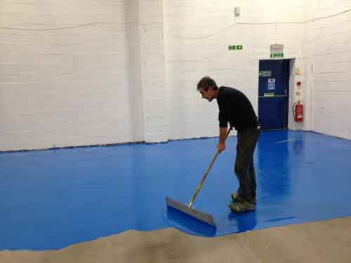 Warehouse Floor Painting Squeegee Application